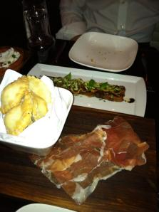 Cassoncini (swiss chard and crescenza cheese filled fried dough, prosciutto di parma) shown in front; and Pancetta (pork belly, figs, balsamic, pistachios) shown behind